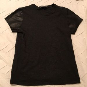 Black T-shirt with faux leather sleeves